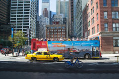 Visit new york city. New York City, USA - August 4,2013:bicycles, taxis and buses for tourists are just some of the many ways to visit new york royalty free stock images