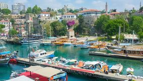 Visit old Antalya. ANTALYA, TURKEY - MAY 6, 2017: Marina is the old tourist harbor, located in Kaleici neighborhood with many pleasure boats, cafes and outdoor stock video