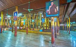 Visit oldest monastery on Inle Lake, Myanmar. YWAMA, MYANMAR - FEBRUARY 18, 2018: The wooden prayer hall  of Nga Phe Chaung Monastery of jumping cats boasts Royalty Free Stock Images