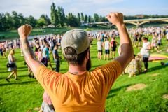 Visit summer festival. Guy celebrate holiday or festival. Summer fest. Man bearded hipster in front of crowd. Open air. Concert. Book ticket now. Early bird stock image