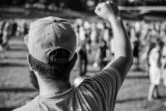 Visit summer festival. Guy celebrate holiday or festival. Summer fest. Man bearded hipster in front of crowd. Book. Ticket now. Open air concert. City day stock image
