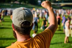 Visit summer festival. Guy celebrate holiday or festival. Summer fest. Man bearded hipster in front of crowd. Book. Ticket now. Open air concert. City day stock images