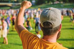Visit summer festival. Guy celebrate holiday or festival. Summer fest. Man bearded hipster in front of crowd. Book royalty free stock images