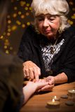 Visit to a fortune-teller Royalty Free Stock Image