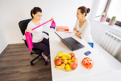 Visit to the nutritionist doctor. Woman during a nutritionist doctor consultation Royalty Free Stock Photo