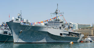 Visit of US navy 7th Fleet flagship in the russia Vladivostok. Near the russian frigate Royalty Free Stock Photography