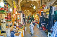 Visit Vakil Bazaar, Shiraz, Iran. SHIRAZ, IRAN - OCTOBER 14, 2017: Alley of Vakil Bazaar is always crowded, local stalls offer fragrant spices, dried fruits royalty free stock photos