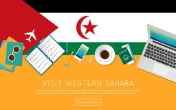 Visit Western Sahara concept for your web banner. Visit Western Sahara concept for your web banner or print materials. Top view of a laptop, sunglasses and Stock Photos