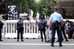 A visita do líder chinês acende protestos em H.K. Foto de Stock