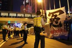 A visita do líder chinês acende protestos em H.K. Imagem de Stock Royalty Free