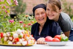 Visitar a una mujer mayor Imagen de archivo libre de regalías