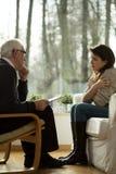 Visite au bureau du psychothérapeute Photo stock