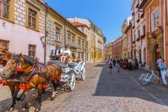 Visite de chariot de cheval de Cracovie (Cracovie) - Pologne Images stock