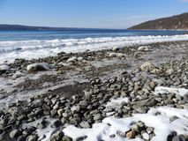 Cayuga Lake shoreline vista in winter. Visited just after a sub-zero cold front passed through the area. Cayuga Lake is the longest of central New York`s glacial royalty free stock images