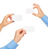 Visitenkarten in den Händen Lizenzfreies Stockfoto