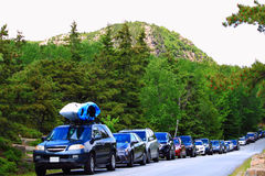 Visiting Acadia National Park Maine. Visiting Acadia National Park, cars line up on Acadia Park Loop Road, Maine USA Stock Images