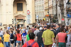 Unidentified tourists in Prague city centre Stock Photos