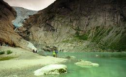 Visiting the Briksdal glacier Stock Image