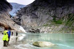 Visiting the Briksdal glacier Stock Images