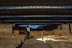 Visiting Cancho Roano at night with moonlight, Zalamea, Badajoz,. Visiting Cancho Roano at night with moonlight. Tartessian Archeological Site near to Zalamea de Stock Image