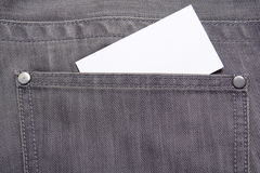 Visiting card in back pocket of grey jeans Stock Image