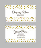 Visiting card with golden foil heart shape design. Stock Photos
