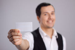 Visiting card in hand with smile Stock Image