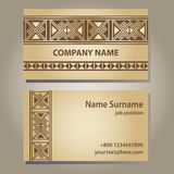 Visiting card template in beige gold with ethnic g Stock Photos