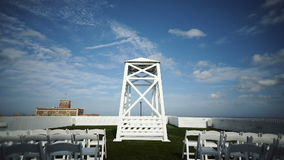 Visiting ceremony on the background of the ocean. The decor is in white tones and in the middle is a white large stock video