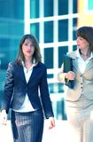 Visiting A Client. Two business women leaving a client's office Stock Photo