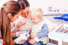 Visiting a dentist. Little boy is unhappy after unpleasant experience with dentist doctor. New meeteing with dentist, setting up a contact Stock Images