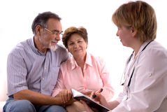 Visiting a doctor. Senior couple visiting a doctor Royalty Free Stock Photography