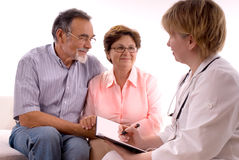Visiting a doctor Stock Images