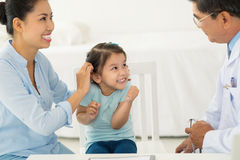 Visiting doctor. Little Asian girl and mother visiting doctor Royalty Free Stock Photography