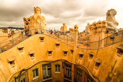 Visiting Gaudi house. Gaudi architecture style very appreciated by tourists in Barcelona Royalty Free Stock Image