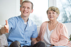 Visiting guests. Young male therapist and older lady visiting guests Royalty Free Stock Photography