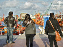 Visiting the harbour. A family visiting Mar del Plata harbour in Argentina in a cold day of winter Stock Image