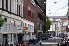 Busy street in Amsterdam, Holland, Netherlands royalty free stock images