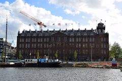 Het scheepvaarthuis - Boat tour along the canals of Amsterdam, Holland, Netherlands royalty free stock photos
