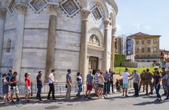 Visiting the Leaning Tower of Pisa - waiting line at entrance - PISA ITALY - SEPTEMBER 13, 2017 Stock Image
