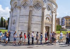 Visiting the Leaning Tower of Pisa - waiting line at entrance - PISA ITALY - SEPTEMBER 13, 2017 Royalty Free Stock Photo