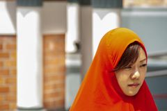 Woman in red clothes in the Kuala Lumpur Mosque royalty free stock photo