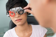 Visiting optician Stock Images