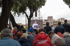 Visiting Rome. The crowd at Holy Mass of canonization of Pope John Paul II and Pope John XXIII. At the castle Angel. Rome, Italy.  April 27, 2014 Stock Image