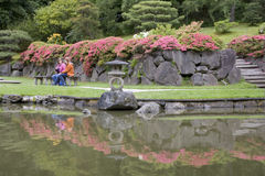 Visiting Seattle Japanese Garden. Visitors were relaxing at the picturesque Seattle Japanese on Saturday afternoon in spring Royalty Free Stock Photo