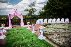 Visiting wedding registration, white chairs decorated for wedding, pink wedding arch Royalty Free Stock Photo