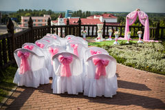 Visiting wedding registration, white chairs decorated for wedding, pink wedding arch Stock Photos
