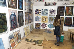Young woman at art exhibition Stock Images