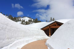 Kohm Yah-mah-nee Visitor Center at Lassen Volcanic National Park in Spring, California. Deep snow at the Visitor Center of Lassen Volcanic National Park in Stock Image