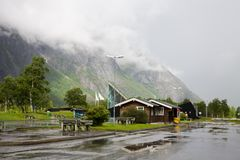 Visitor centre Trollstigen and parking place on the way to the Trolls Path. The Trolls Path Trollstigen is a serpentine mountain road, popular tourist object in stock images